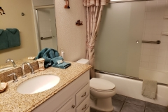 Bathroom includes a new vanity, refinished tub that includes grab bars