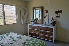 Behr's Escape new bedroom furniture and mirrored closet doors.